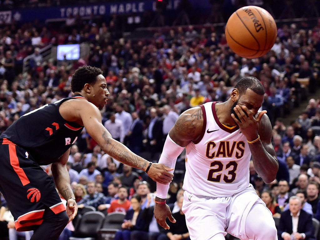 . Cleveland Cavaliers forward LeBron James (23) reacts after being fouled by Toronto Raptors guard DeMar DeRozan, left, during the second half of an NBA basketball game Thursday, Jan. 11, 2018, in Toronto. (Frank Gunn/The Canadian Press via AP)