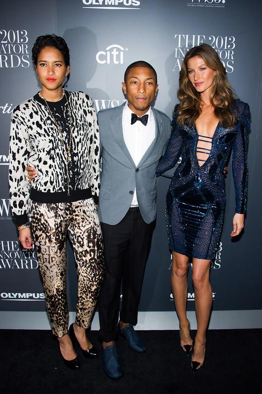 . Helen Lasichanh, from left, Pharrell Williams and Gisele Bundchen attend the WSJ. Magazine\'s Innovator Awards on Wednesday, Nov. 6, 2013 in New York. (Photo by Charles Sykes/Invision/AP)