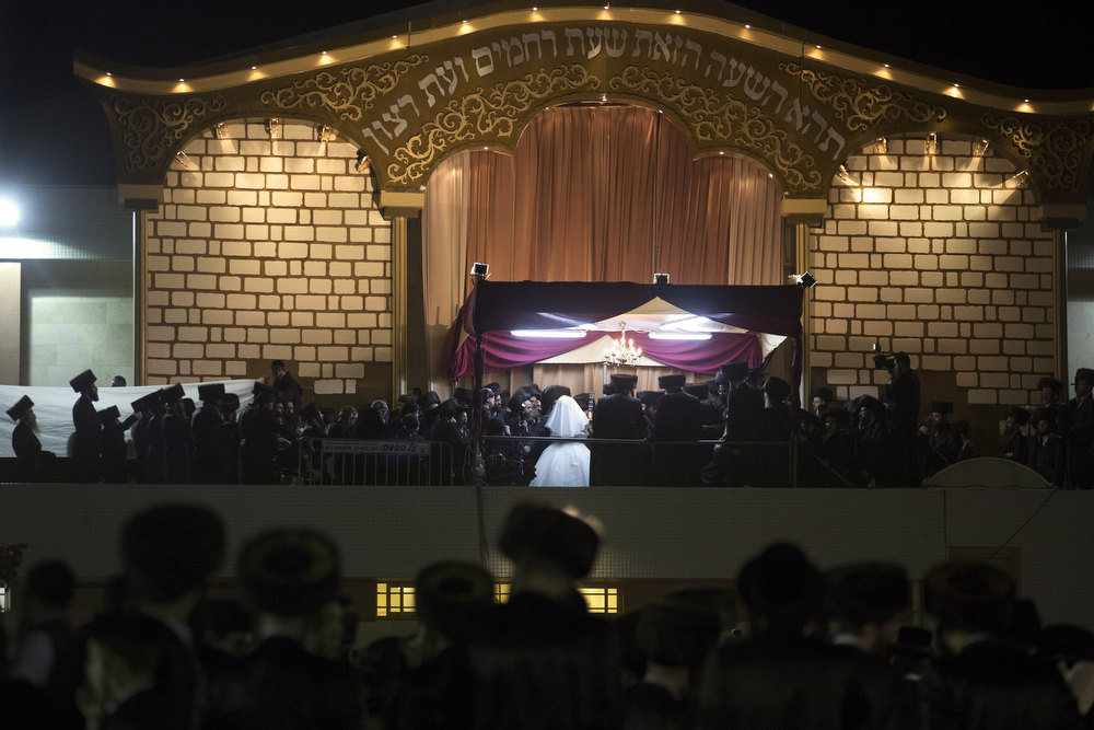 Description of . A Jewish bride takes part in a ceremony during her wedding to the great-grandson of the Rabbi of the Tzanz Ultra-Orthodox Hasidic community in Netanya, on January 2, 2013. MENAHEM KAHANA/AFP/Getty Images