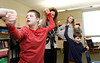 Noah, Hillyer, Keegan and ? singing and dancing around the room during the CARE worship program at St Michael the Archangel. Photo by Susan McSpadden 011313