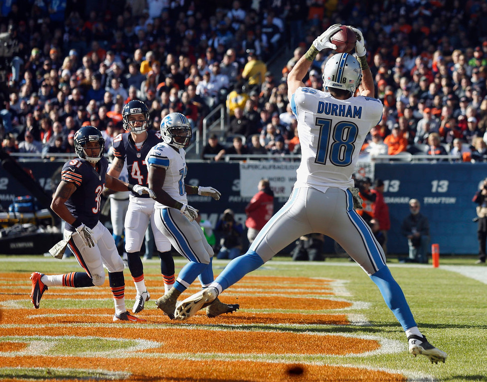. Detroit Lions wide receiver Kris Durham (18) makes a touchdown reception during the first half of an NFL football game against the Chicago Bears, Sunday, Nov. 10, 2013, in Chicago. (AP Photo/Charles Rex Arbogast)