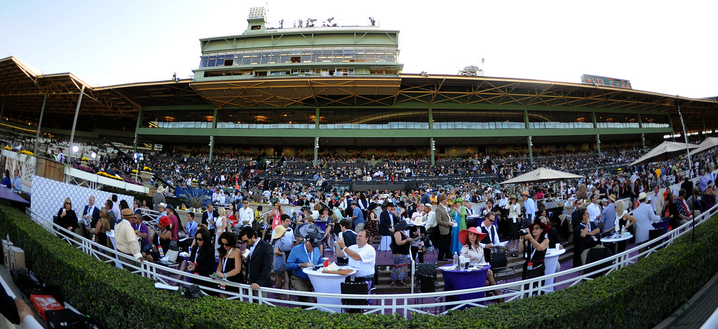 ". Fans look on as Jockey Martin Garcia (not pictured) atop ""Secret Circle\"" celebrates in the wining circle after winning the Xpressbet Breeders\' Cup Sprint in the tenth race during the Breeders\' Cup at Santa Anita Park in Arcadia, Calif., on Saturday, Nov. 2, 2013.    (Keith Birmingham Pasadena Star-News)"