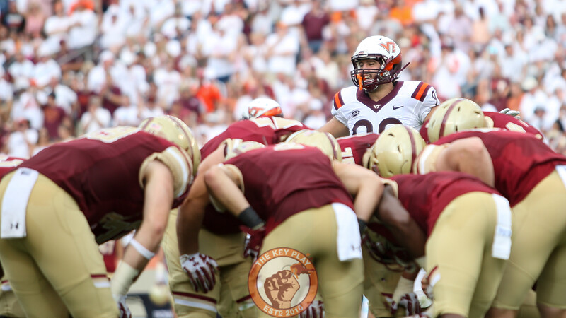DL Vinny Mihota calls out a play as Boston College's offense huddles in front of him. (Mark Umansky/TheKeyPlay.com)