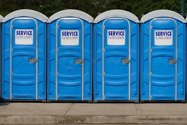 Row of Portable Blue Toilets