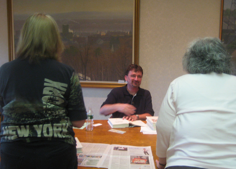 Author Timothy Black signing copies of his book for Friends,  May 20, 2010.