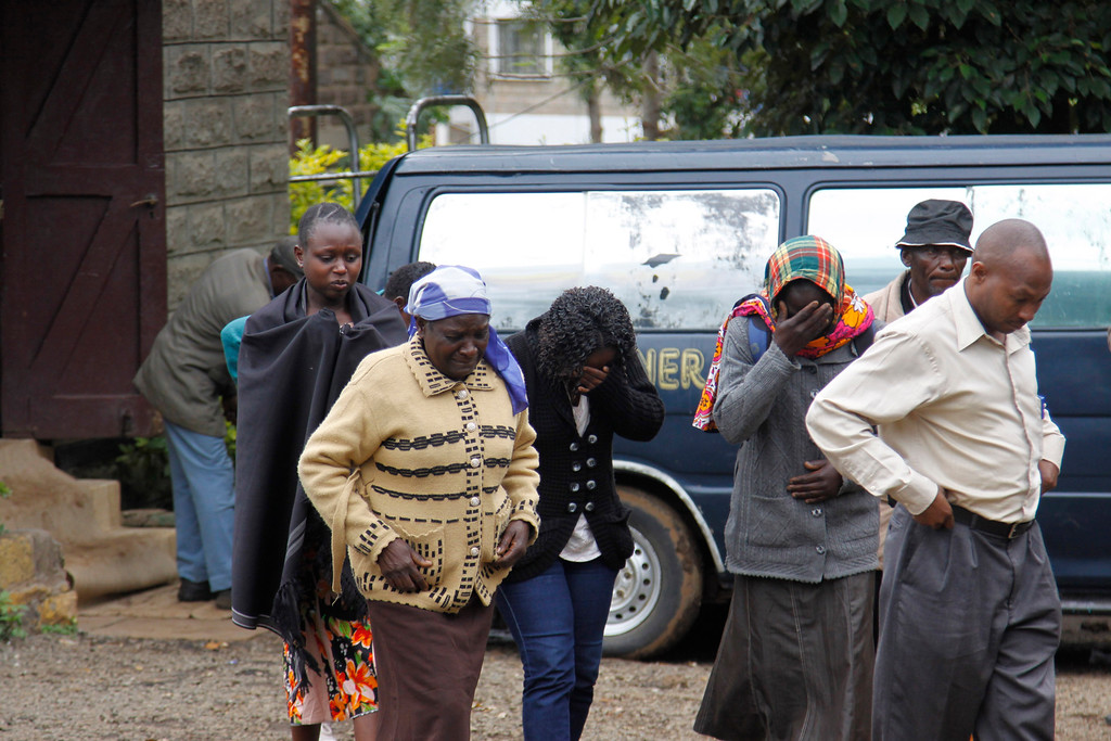 . Family members, react,  outside the Nairobi City Mortuary in Nairobi, as they mourn the death of loved ones killed in the Westgate attack in Nairobi, Kenya Tuesday, Sept. 24, 2013. Islamic militants who staged a deadly attack on a Kenya mall said Tuesday hostages are still alive and fighters are \'still holding their ground,\' as Nairobi\'s city morgue prepared for the arrival of a large number of bodies of people killed, an official said.  (AP Photo/Khalil Senosi)