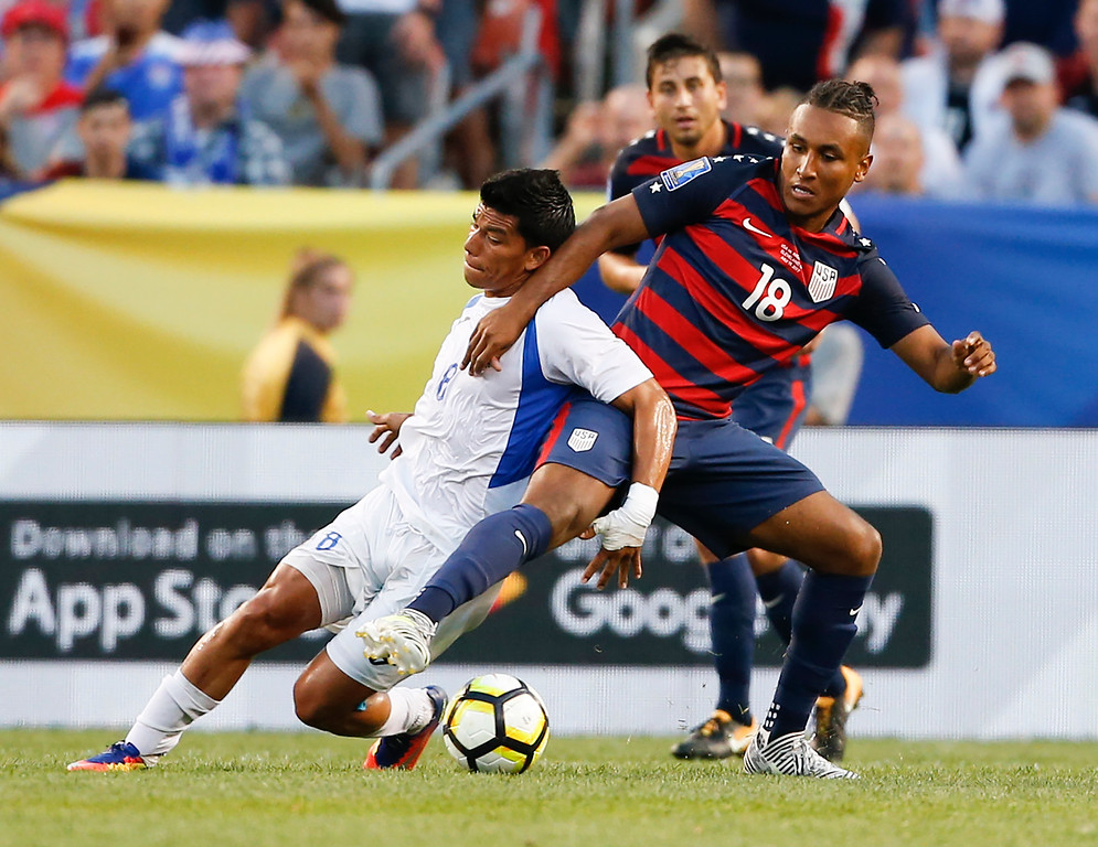 . United States\' Juan Agudelo (18) and Nicaragua\'s Marlon Lopez (8) battle for the ball during a CONCACAF Gold Cup soccer match in Cleveland, Saturday, July 15, 2017. (AP Photo/Ron Schwane)