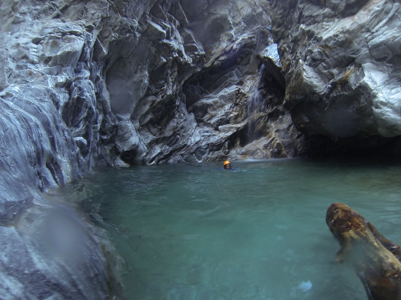 Alyssa swimming in the glacier pool after jumping 24 feet