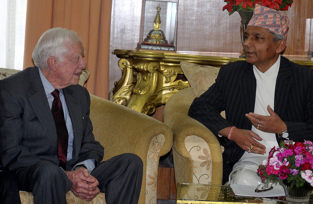 . Former US President Jimmy Carter (L) talks with Chairman of the Interim Election Government Khilraj Regmi during a meeting in Kathmandu on March 30, 2013. Carter has arrived in Kathmandu on four day visit. AFP PHOTO/Bhawor OJHASTR/AFP/Getty Images