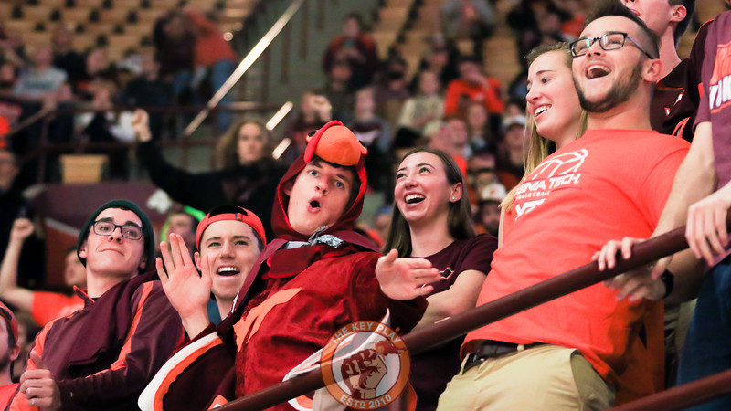 Students in the front row dance for a competition during a media timeout. (Mark Umansky/TheKeyPlay.com)