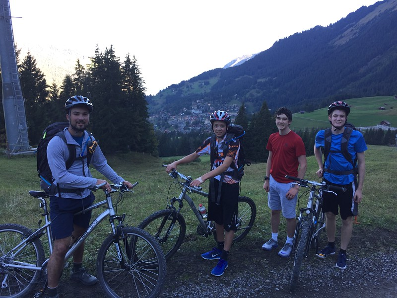 Mr. Garczynski, Jack, Eric, and Henry with Wengen in the background (the start of a long uphill)