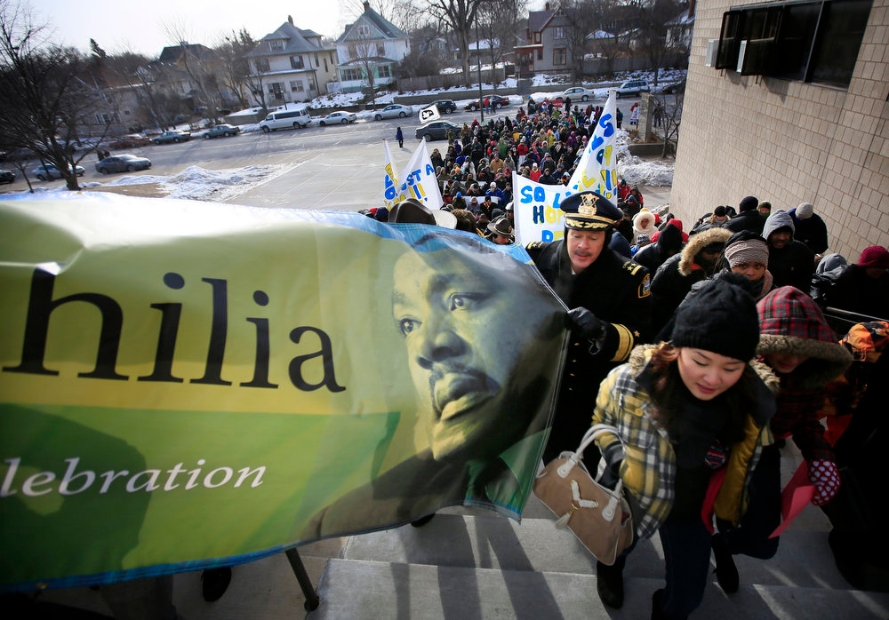 ". St. Paul\'s Martin Luther King Day Celebration ""Moving Beyond Tolerance to Allophilia\"" is kicked off with an abbreviated march and then a speech by Kevin Lindsey, Commissioner of Minnesota Department of Human Rights.  (AP Photo/The Star Tribune, Brian Peterson)"