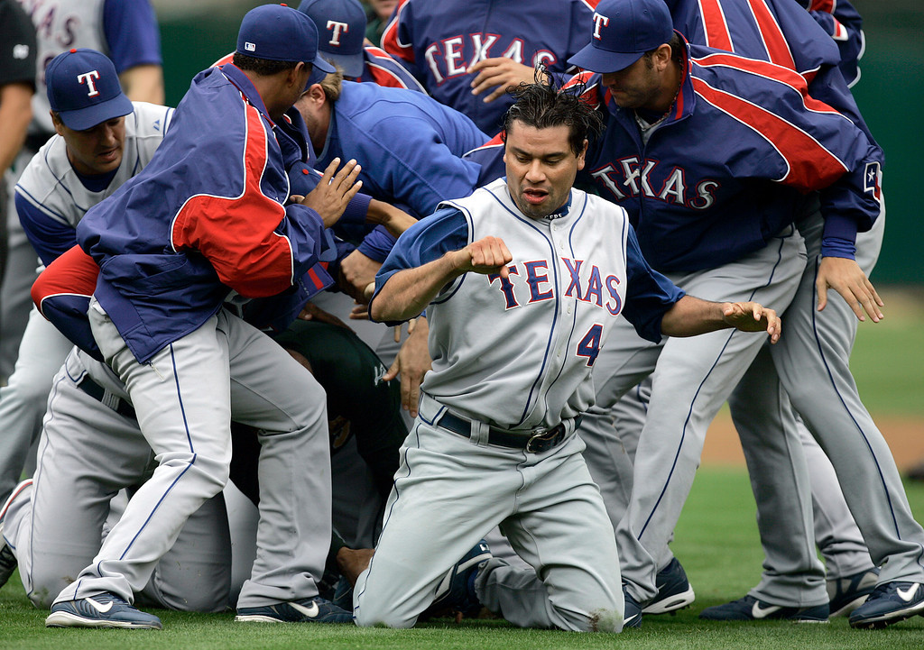 . Texas Rangers pitcher Vicente Padilla emerges from a bench-clearing brawl after hitting Oakland Athletics\' Nick Swisher with a pitch in the first inning of a baseball game Sunday, Sept. 16, 2007, in Oakland, Calif.  Both Swisher and Padilla were ejected from the game. (AP Photo/Ben Margot)