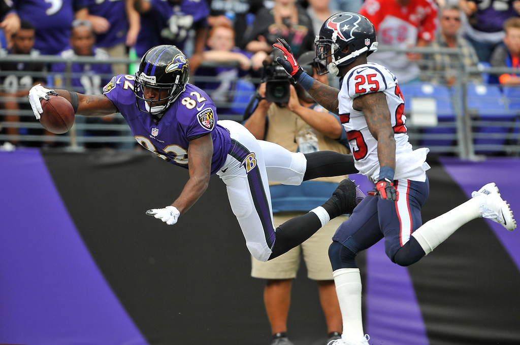 . Wide receiver Torrey Smith #82 of the Baltimore Ravens leaps towards the end zone but does not score against the Houston Texansat M&T Bank Stadium on September 22, 2013 in Baltimore, Maryland. The Ravens defeated the Texans 30-9. (Photo by Larry French/Getty Images)