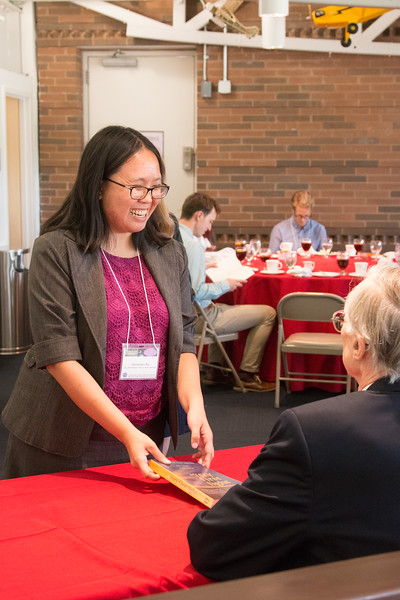 "Christina Chu (2014 Scholar)  with John Mather, as he signs copies of his book ""The Very First Light"" -- An award luncheon, ""Dr. John Mather Nobel Scholars Program Award"", as part of the National Space Grant Foundation. College Park Aviation Museum, College Park, MD, August 2, 2019."