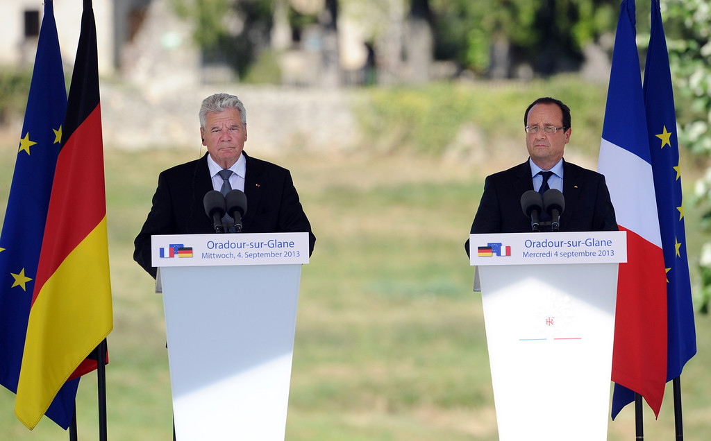 . French president Francois Hollande (R) and his German counterpart Joachim Gauck give a joint press conference on September 4, 2013 after visiting the ruins of the French village of Oradour-sur-Glane. The town has become a ghostly war crimes museum since Nazi troops burnt it to the ground on June 10, 1944. Six hundred and forty-two original inhabitants were massacred in Oradour and no one knows exacty why. Women and chldren were massacred in the church before their bodies were burnt by a German SS division. Hebras is one of three survivors still alive. NICOLAS TUCAT/AFP/Getty Images