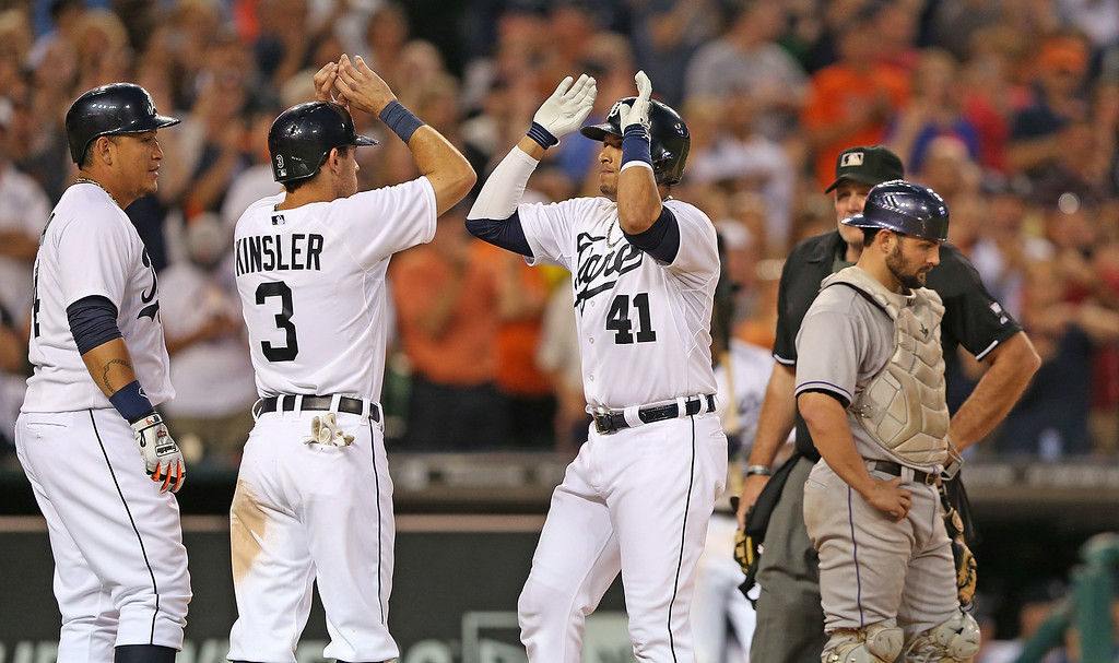 . DETROIT, MI - AUGUST 02: Victor Martinez #41 of the Detroit Tigers celebrates after hitting a three-run home run to center field scoring Ian Kinsler #3 and Miguel Cabrera #24 (not in photo) during the fifth inning of the game against the Colorado Rockies at Comerica Park on August 2, 2014 in Detroit, Michigan.  (Photo by Leon Halip/Getty Images)
