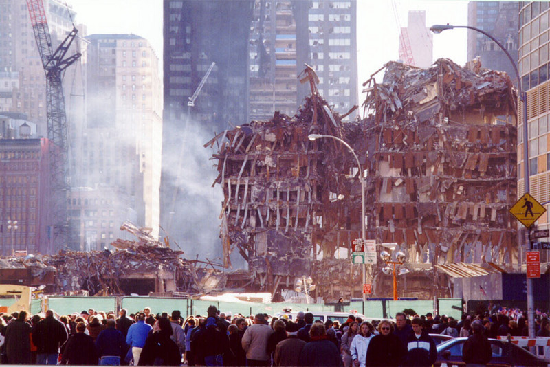 Remains of World Trade Center buildings destroyed in the Sept. 11 terrorist attacks draw onlookers to lower Manhattan. Work crews have removed much of the above-ground debris at the site.