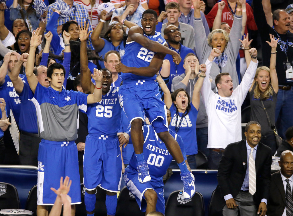 . Kentucky forward Alex Poythress (22) reacts after a three-point basket during the second half of an NCAA Final Four tournament college basketball semifinal game against Wisconsin Saturday, April 5, 2014, in Arlington, Texas. Kentucky won 74-73. (AP Photo/Tony Gutierrez)