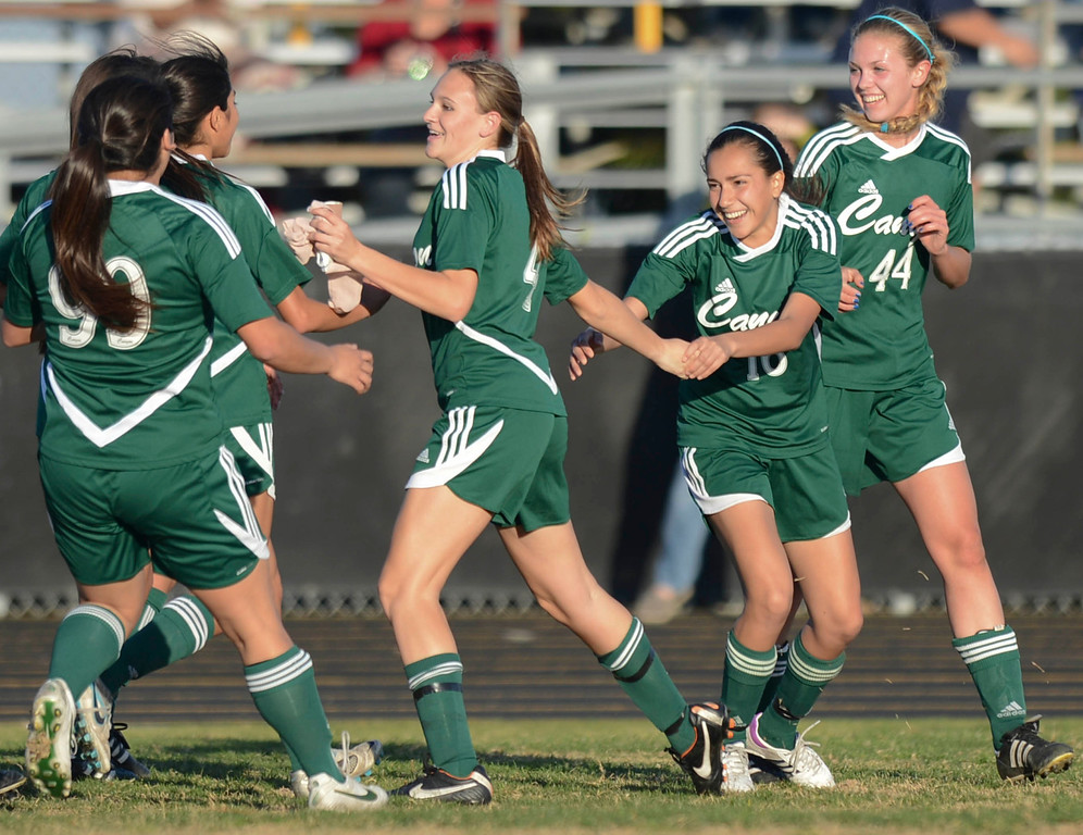 . Canyon, including Mari Kneisel who scored the winning goal, celebrates their win over Peninsula in a CIF SS Division II first round soccer game Thursday in Rolling Hills Estates. After Peninsula seemingly dominated most of the game, Canyon scored a goal in the final two minutes to win 1-0. 20130214 Photo by Steve McCrank / Staff Photographer