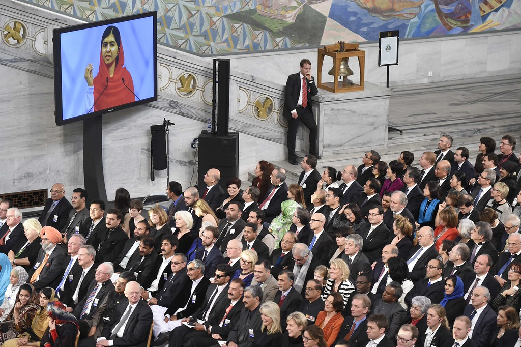 . A giant screen displays Nobel Peace Prize laureate  Malala Yousafzai  delivering her speech during the Nobel Peace Prize awarding ceremony at the City Hall in Oslo on December 10, 2014.  The 17-year-old Pakistani girls\' education activist Malala Yousafzai known as Malala shares the 2014 peace prize with the Indian campaigner Kailash Satyarthi, 60, who has fought for 35 years to free thousands of children from virtual slave labour.  AFP PHOTO / ODD ANDERSENODD ANDERSEN/AFP/Getty Images