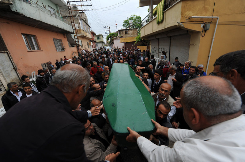 . People mourn as they carry the coffin of Ogulcan Tuna, 18 year, on May 12, 2013 during the funerals of the victims of a car bomb which went off on May 11 at Reyhanli in Hatay just a few kilometers from the main border crossing into Syria. Turkey was reeling from twin car bomb attacks which left at least 43 people dead in a town near the Syrian border, with Ankara blaming pro-Damascus groups and vowing to bring the perpetrators to justice. A Syrian minister denied on May 12 accusations that Damascus was behind a bomb attack in a Turkish town that left dozens dead, a day after Ankara blamed supporters of President Bashar al-Assad for the blasts.   BULENT KILIC/AFP/Getty Images