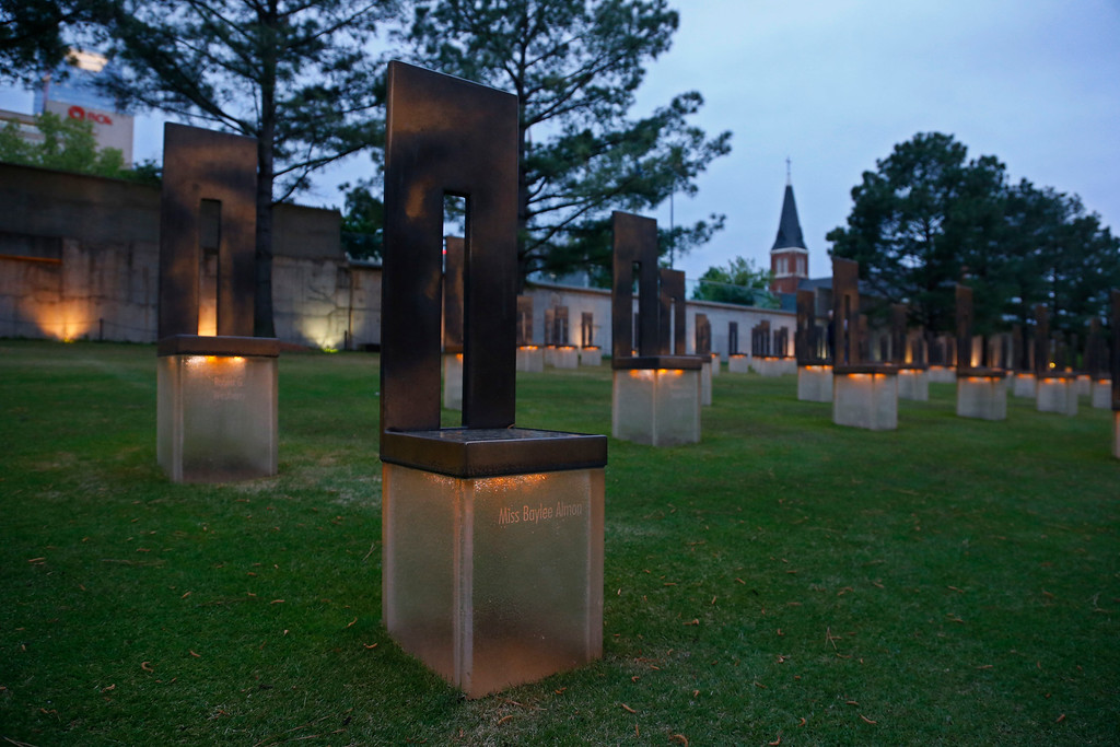 . The chair dedicated to bombing victim Baylee Almon is pictured in the Field of Empty Chairs at the Oklahoma City National Memorial at dusk in Oklahoma City, Tuesday, April 14, 2015. Sunday will be the 20th anniversary of the Oklahoma City bombing. The  Alfred P. Murrah Federal Building,was located where the Field of Empty Chairs is now. Almon was the baby pictured in the iconic Pulitzer Prize-winning photo of the bombing. (AP Photo/Sue Ogrocki)