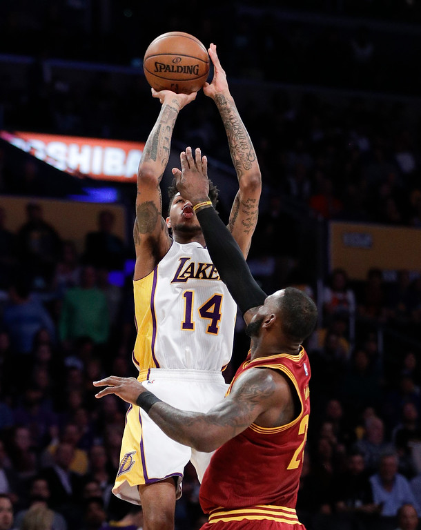 . Los Angeles Lakers\' Brandon Ingram, top, shoots over Cleveland Cavaliers\' LeBron James during the first half of an NBA basketball game Sunday, March 19, 2017, in Los Angeles. (AP Photo/Jae C. Hong)