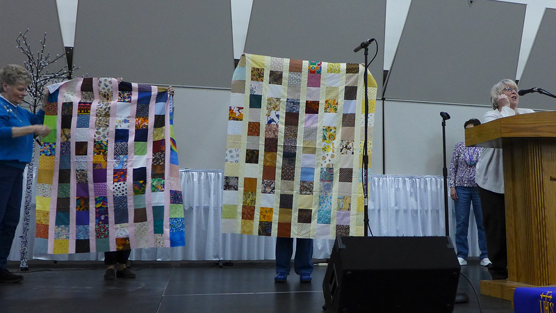 Jan Babcock told us the story of her Charm Exchange Group did a year long exchange and she had 1,200  charm squares.  The squares made 8 of the quilt tops shown.  The squares are now all gone.  Exchange was in 1996