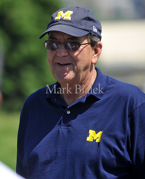 Former U-M head football coach Lloyd Carr smiles after a few of his former players yelled and disrupted his backswing for fun during the Griese Hutchinson Woodson Champion for Children's Hearts charity golf event at the U-M golf course in Ann Arbor on May 20, 2012.  Money was raised for Mott Children's Hospital.  MARK BIALEK/Special to the Free Press