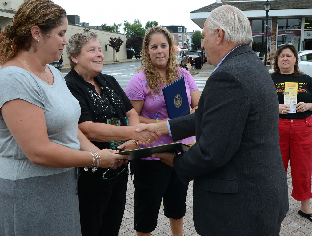 . Senator Bob Mensch hands a proclamation to Dorothy Frederick (2nd from L) and her daughters Stephanie (L) and Karen Diehl after the the Lansdale Borough Lifetime Achievement Award was presented to the late Stephen Frederick  during the Lansdale Founders Day  celebration and on Saturday August 23,2014. Photo by Mark C Psoras/The Reporter