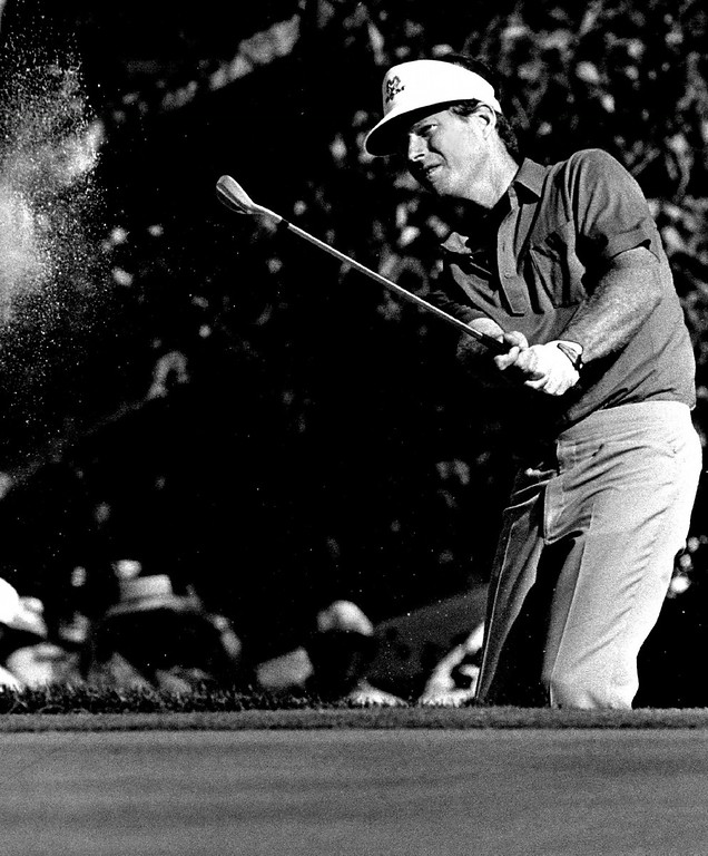. Tom Watson blasted out of trap just below the 18th green Saturday during second to last day of 1985 PGA tournament. Karl Gehring, The Denver Post