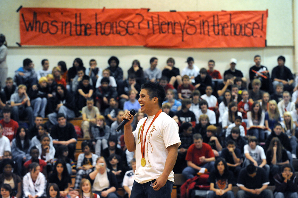 . (HR) ABOVE: Henry Cejudo addresses the packed audience of students, teachers and local dignitaries that turned out to see him. 2006, Coronado High School graduate Heny Cejudo made a triumphant return to Colorado Springs to his old alma mater.  This was his first visit back to Colorado since capturing the gold medal in free style wrestling at the 2008 Beijing Summer Olympic Games.  Cejudo was a two-time Colorado State wrestling champion while attending Coronado High School.  He was undefeated as Colorado prep, and is widely known as one of the greatest high school wrestlers in American history.  Cejudo became the youngest American ever (21 years old) to win an Olympic gold medal in freestyle wrestling  (55kg weight class.) To honor Cejudo\'s homecoming, Coronado High School held a school wide assembly in the main gym.  The assembly gave students the opportunity to celebrate the gold medal performance with Henry and at the same time, allowing Coronado to honor Cejudo for his outstanding accomplishment. Helen H. Richardson/The Denver Post