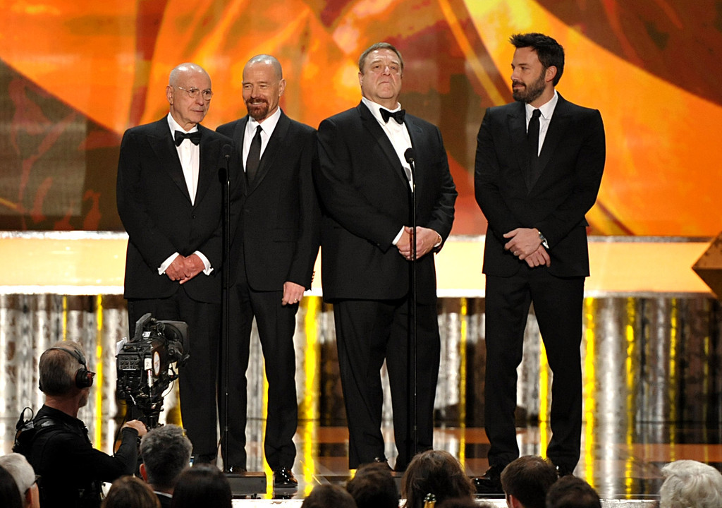 ". Castmembers from ""Argo\"", from left, Alan Arkin, Bryan Cranston, John Goodman and Ben Affleck speak onstage at the 19th Annual Screen Actors Guild Awards at the Shrine Auditorium in Los Angeles on Sunday Jan. 27, 2013. (Photo by John Shearer/Invision/AP)"