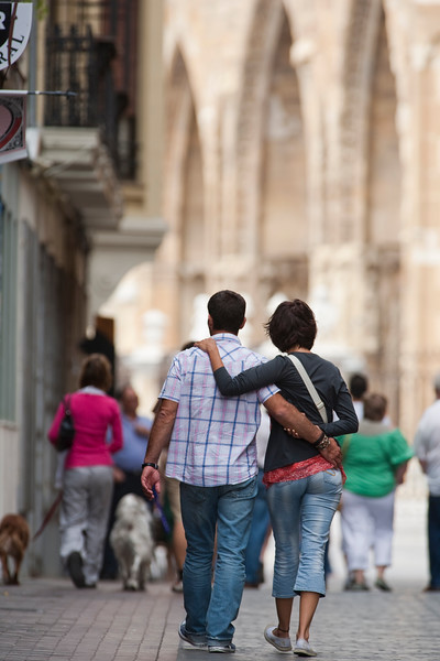 Couple walking on the street with the Cathedral on the background, town of Leon, autonomous community of Castilla y Leon, northern Spain
