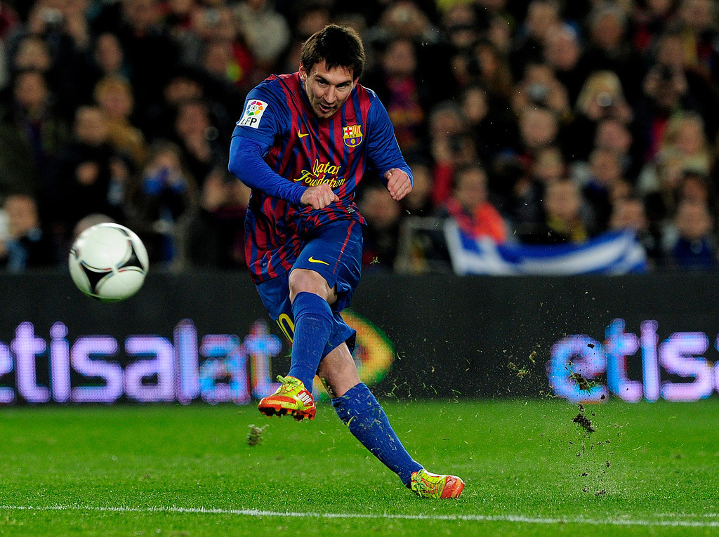 . Barcelona\'s Argentinian forward Lionel Messi kicks the ball during the Spanish Cup football match FC Barcelona vs Osasuna on January 4, 2012 at the Camp Nou stadium in Barcelona.   JOSEP LAGO/AFP/Getty Images