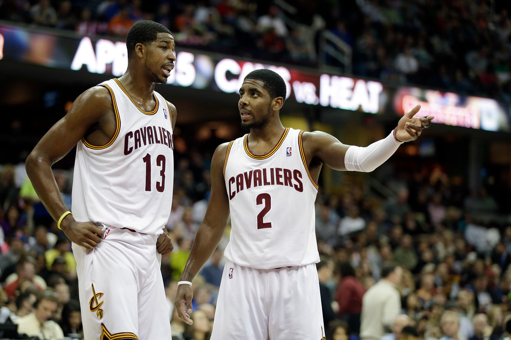 . Cleveland Cavaliers\' Kyrie Irving (2) talks with Tristan Thompson (13) during an NBA basketball game against the New York Knicks Friday, April 12, 2013, in Cleveland. (AP Photo/Mark Duncan)