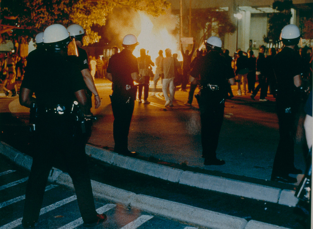 . At Parker Center, the headquarters for the Los Angeles Police Department, rioters destroyed a guard shack and set it on fire the night the King verdicts were read. April 29, 1992. (Photo by John McCoy/Los Angeles Daily News).