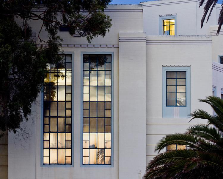 Light on windows of curved building on Treasure Island