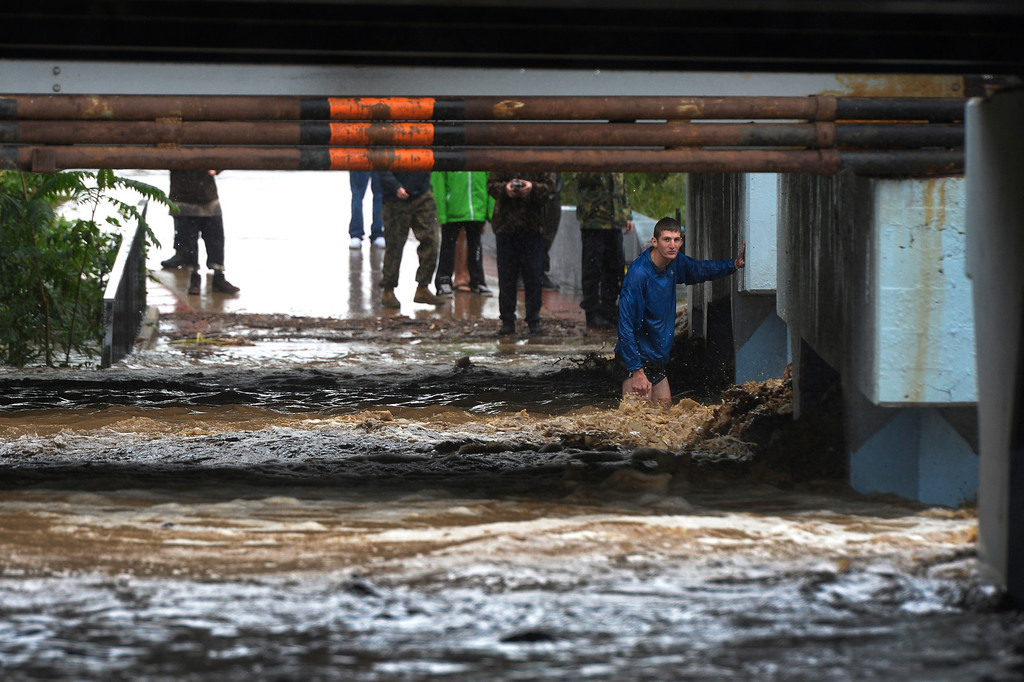 . BOULDER, CO. - SEPTEMBER12:  A man looks over a flooded underpass along Boulder Creek in Boulder, CO September 12, 2013. Record-breaking rain turned normally quiet creeks into raging, brown torrents that swept through Boulder on Thursday, flooding homes, swamping cars and closing roads and schools. (Photo By Craig F. Walker / The Denver Post)