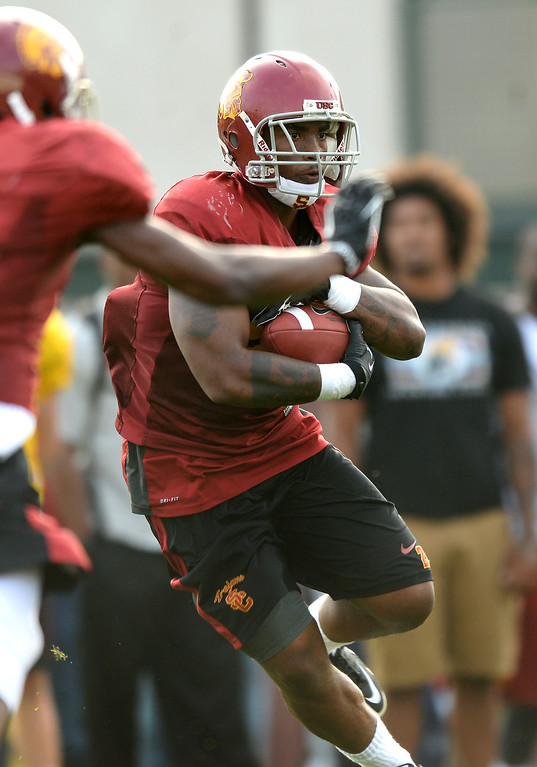. USC RB Tre Madden carries the ball during practice, Tuesday, March 25, 2014, at USC. (Photo by Michael Owen Baker/L.A. Daily News)