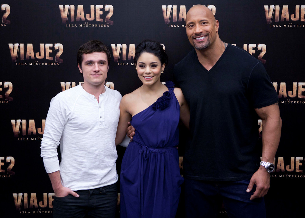 """. Actors Josh Hutcherson, left, Vanessa Hudgens, center, and Dwayne \'The Rock\' Johnson pose for the press at a press conference promoting their new movie \""""Journey 2: The Mysterious Island\"""" in Mexico City, Friday Jan. 27, 2012. (AP Photo/Eduardo Verdugo)"""