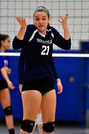 11/7/2018 Mike Orazzi | Staff mmaculate's Melissa Schirmer (21) during the Class S Second Round Girls Volleyball Tournament in Bristol Wednesday night.