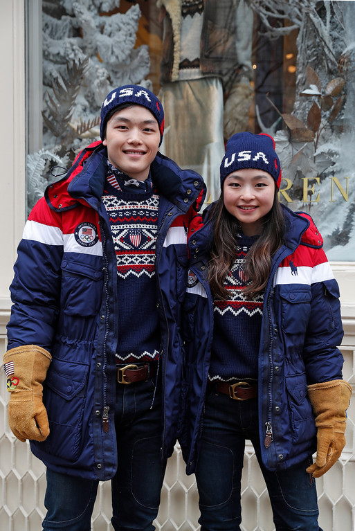 . Sister and brother ice-dancing team Alex and Maia Shibutani pose for photographs wearing Team USA\'s Opening Ceremony uniforms for the upcoming Winter Olympics, Monday, Jan. 22, 2018, in New York. The jackets feature built-in, battery-operated heaters that can be adjusted using a cell phone. The outfits were designed by David Lauren for Polo by Ralph Lauren. (AP Photo/Kathy Willens)
