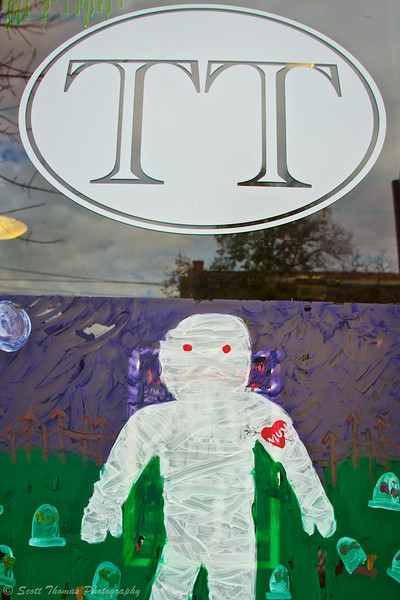 Halloween Window Painting on a tattoo parlor in the Village of Baldwinsville, New York.