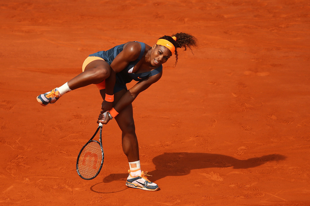 . Serena Williams of United States of America in action in her Women\'s Singles Final match against Maria Sharapova of Russia  during day fourteen of French Open at Roland Garros on June 8, 2013 in Paris, France.  (Photo by Julian Finney/Getty Images)