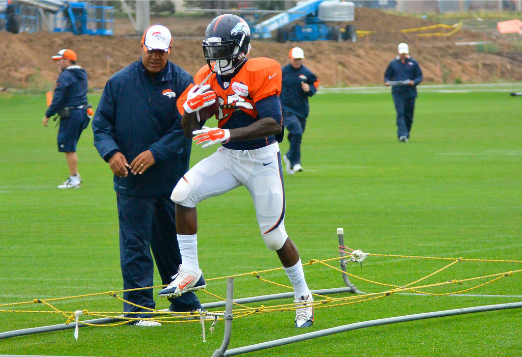 . Denver Broncos running back Ronnie Hillman (23) runs through drills on day seven of the Denver Broncos 2014 training camp July 31, 2014 at Dove Valley. (Photo by John Leyba/The Denver Post)