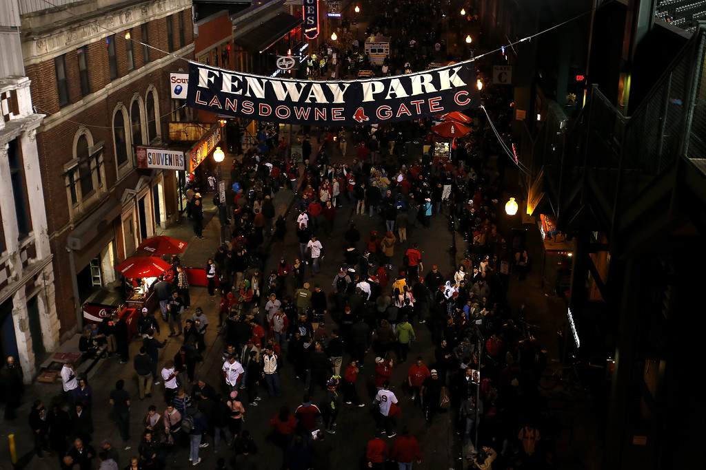 . Fans stand outside Fenway Park for Game Six of the 2013 World Series between the Boston Red Sox and the St. Louis Cardinals on October 30, 2013 in Boston, Massachusetts.  (Photo by Jim Rogash/Getty Images)