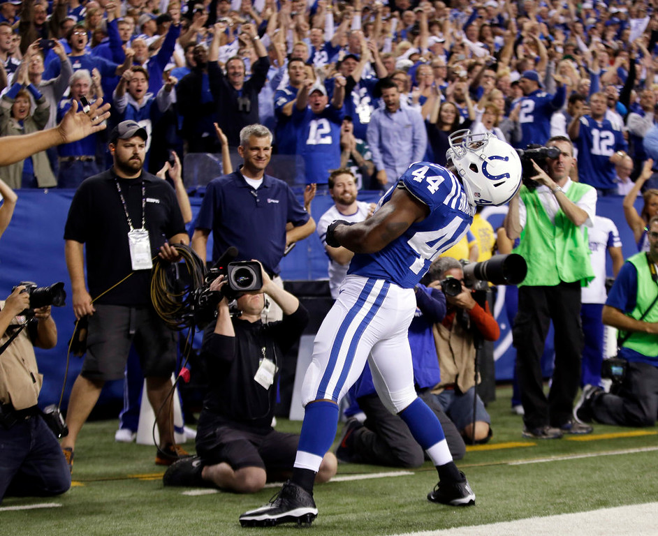 . Indianapolis Colts running back Ahmad Bradshaw (44) celebrates after scoring on a one yard touchdown reception during the first half of an NFL football game against the Philadelphia Eagles Monday, Sept. 15, 2014, in Indianapolis. (AP Photo/AJ Mast)
