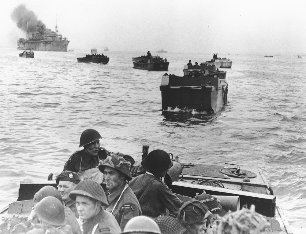 Description of . Canadian troops in landing crafts approach a stretch of coastline code-named Juno Beach, near Bernieres-sur-mer, as the Allied Normandy invasion gets under way, on June 6, 1944. (AP Photo)